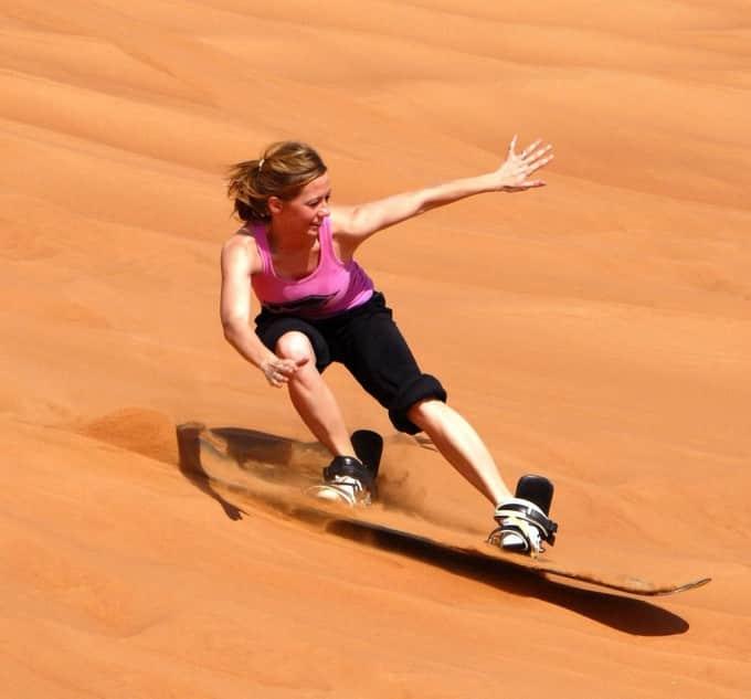 sandboarding-woman-girl