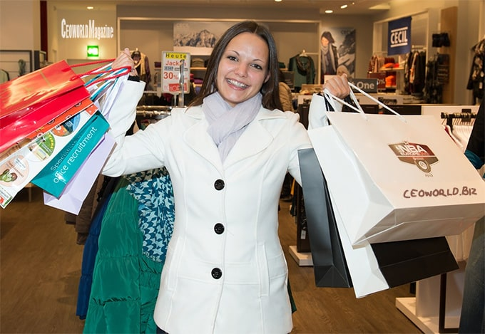 woman-shopping-happy-bags-dresses
