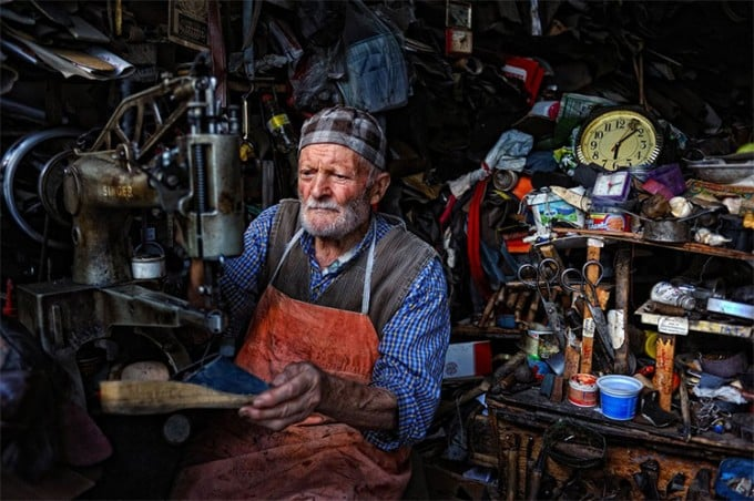Old Turkish man manages a shoe repair shop