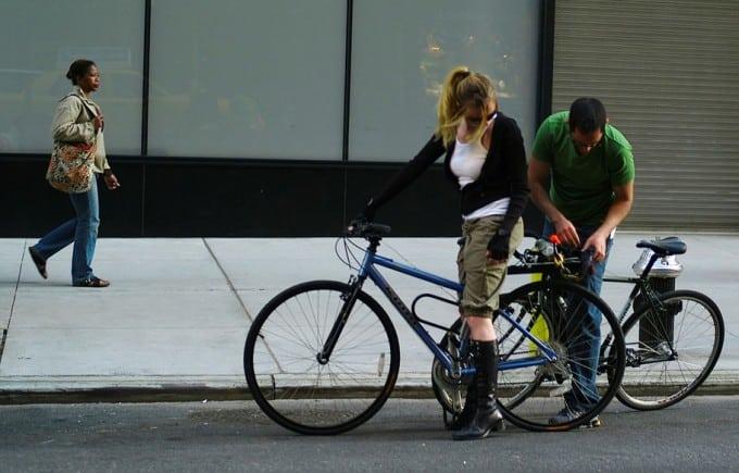 man fixes girl bicycle