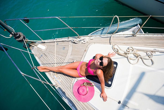 Young-girl-Sailing-On-Yacht-woman-on-boat