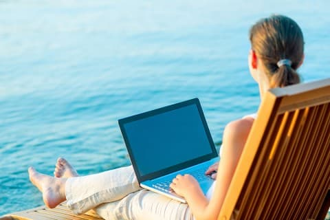 Business Woman with Laptop on beach