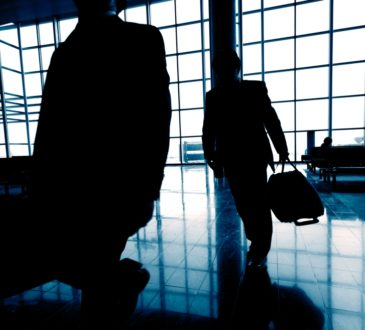 Business Tavelers At Airport