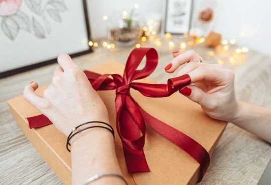 Woman unwrapping present