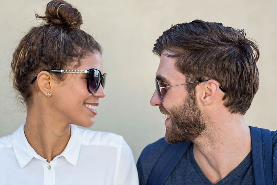 Smiling couple with sunglasses