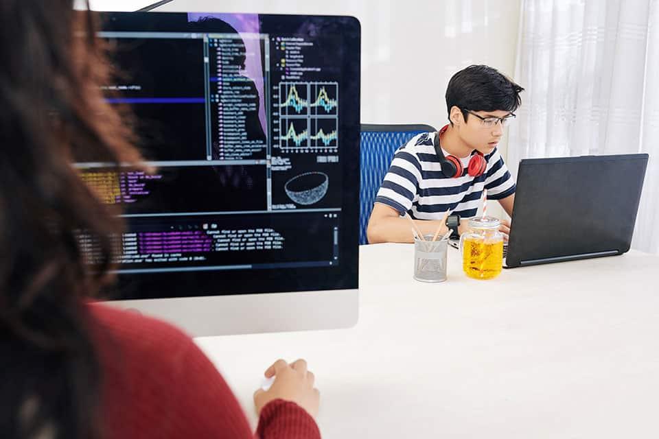 Teenage kids checking programming code