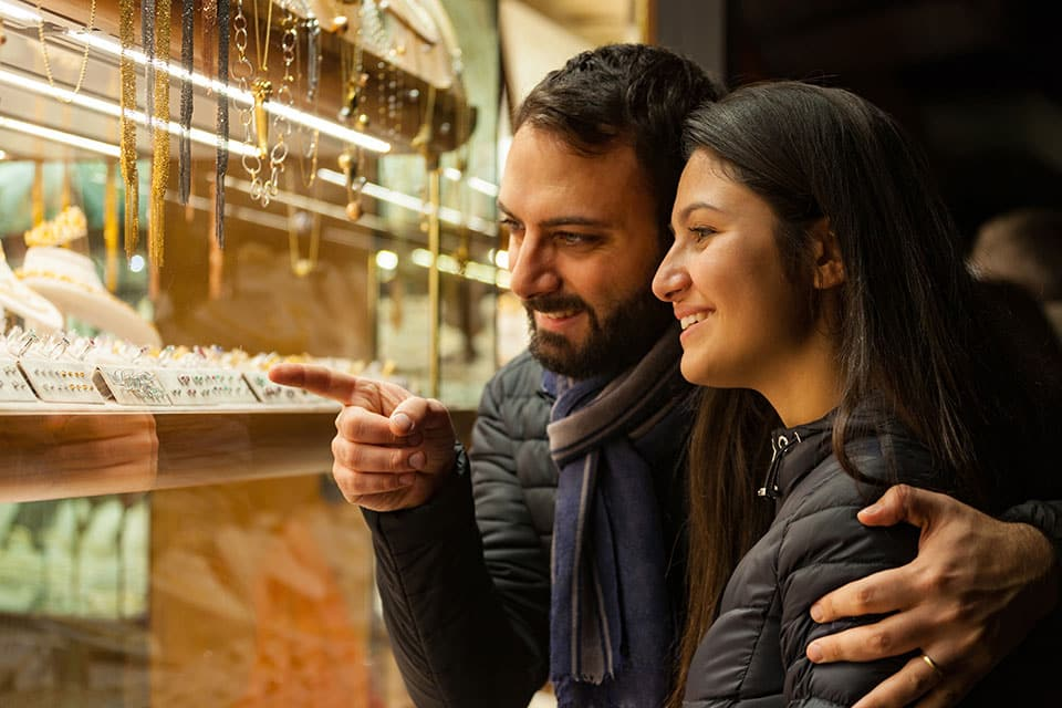 Couple looking at jewelry